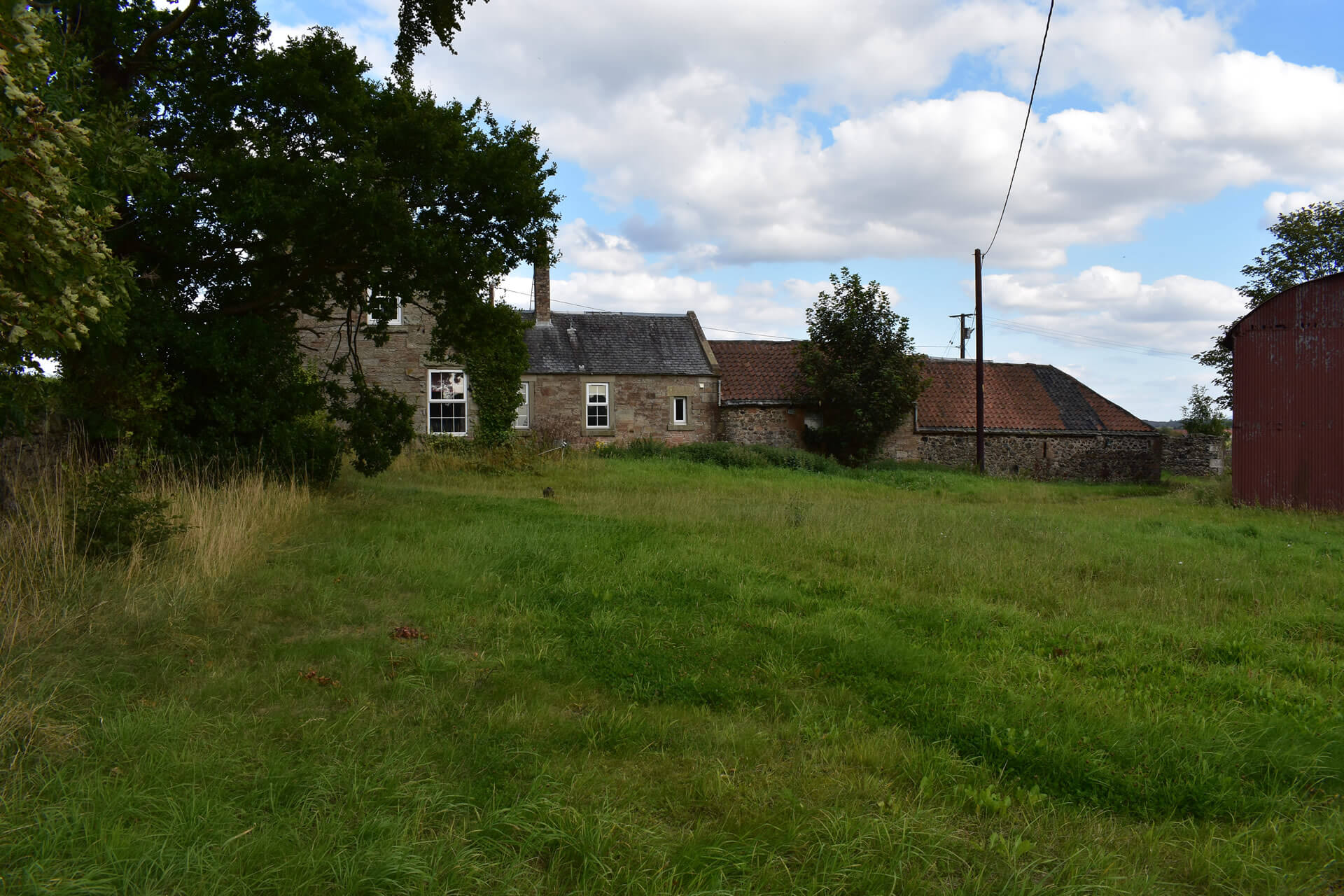 burghmuir farm from field looking at building